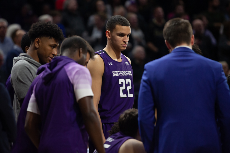 Pete+Nance+stands+in+the+huddle+with+his+teammates.+The+sophomore+forward+has+struggled+in+recent+games+and+is+no+longer+part+of+the+starting+lineup