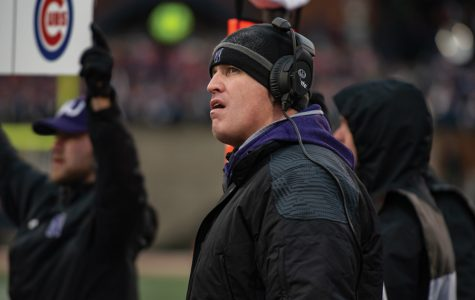 Pat Fitzgerald looks at the replay screen. The head coach heads into the 2020 season one win away from 100 career wins at Northwestern.