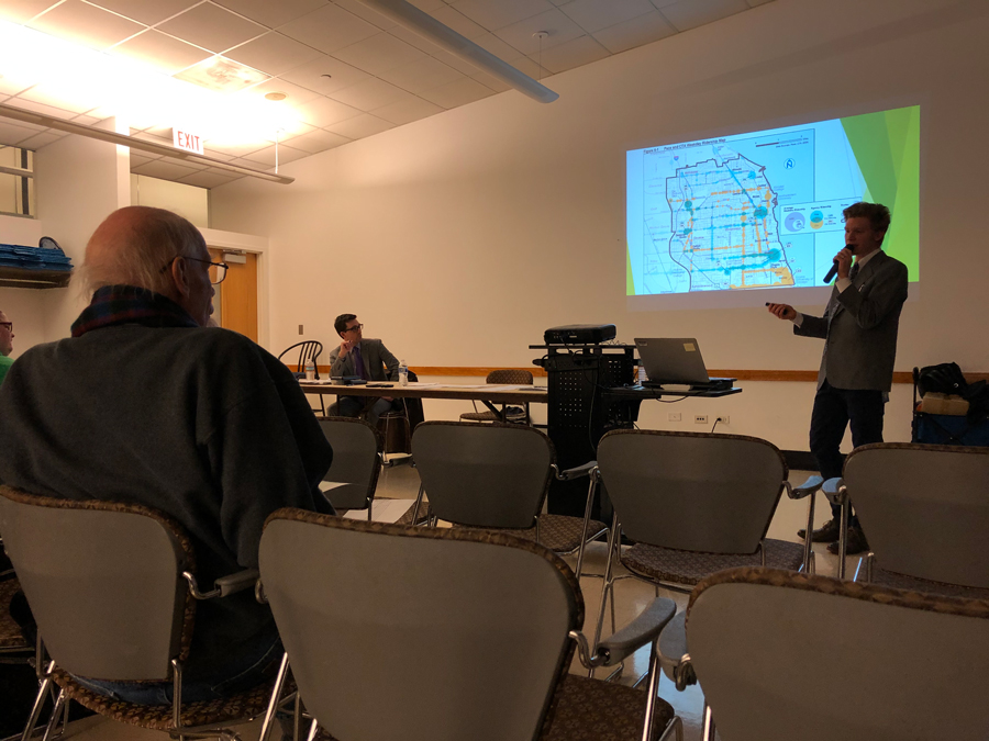 Pace senior planner Christian Turner delivers a presentation detailing the proposed changes to Pace bus routes at a Tuesday meeting. The changes would discontinue Routes 210 and 421, alter Routes 215, 225, 226, 422 and 423, as well as create Route 424