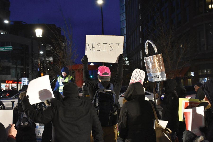 Protesters at Wednesday's rally. Evanston residents gathered to protest Trump's acquittal.