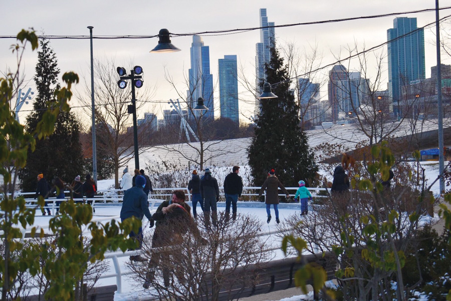 Ice skaters at the Maggie Daley Skating Ribbon. Despite an unusually warm winter, a foundation of ice early in the season and refrigeration systems below the Ribbon have kept the ice solid.