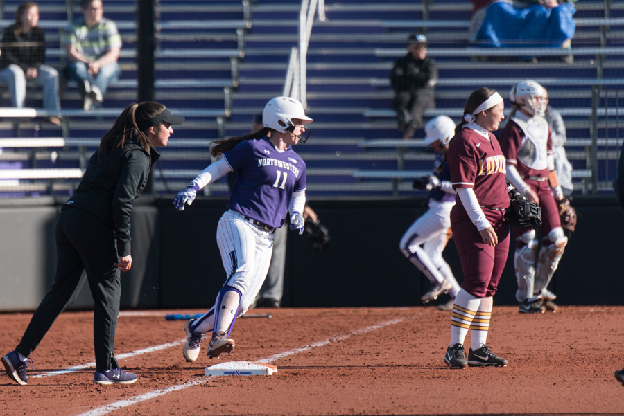 Rachel Lewis pulls up at first base during a 2018 game. The second baseman will lead NU into this weekend's Mary Nutter Classic.
