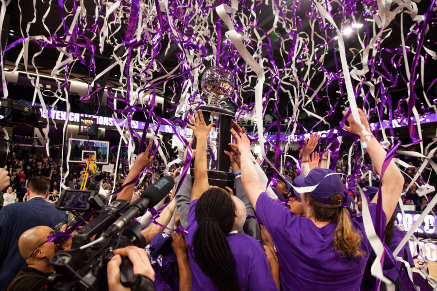(Joshua Hoffman, The Daily Northwestern). Northwestern raises the Big Ten championship trophy. The Wildcats won their first conference championship in 30 years.