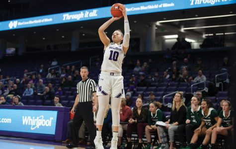 Lindsey Pulliam shoots from behind the arc. The junior is one of NU's best scorers, but struggled against Nebraska on Sunday.