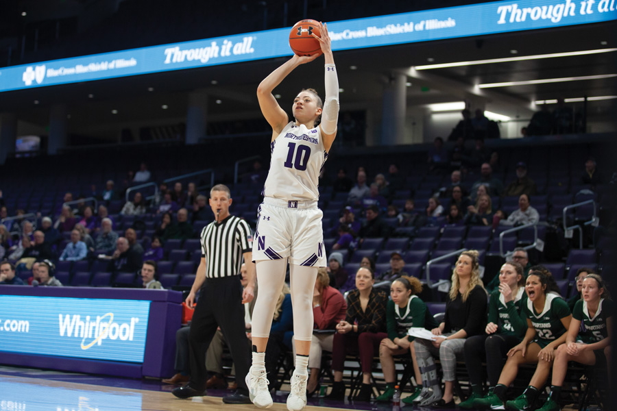 Lindsey+Pulliam+shoots+from+behind+the+arc.+The+junior+is+one+of+NU%E2%80%99s+best+scorers%2C+but+struggled+against+Nebraska+on+Sunday.%0A