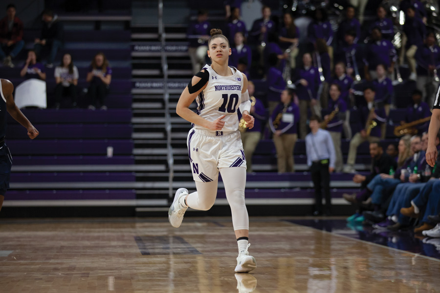 Lindsey+Pulliam+jogs+down+the+court.+The+junior+guard+scored+22+points+during+Northwestern%E2%80%99s+January+win+over+Michigan+State.
