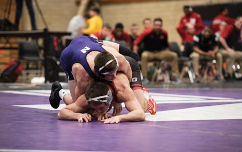 Wrestling: The Wildcats lose nail-biter against in-state rival Illinois 19-18