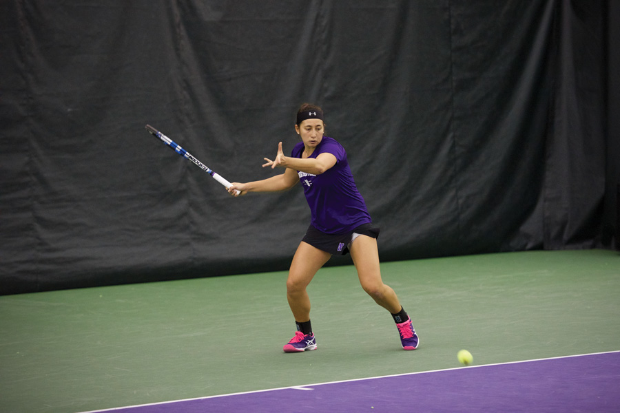 Junior Inci Ogut chases the ball. Ogut helped the Wildcats to a doubles victory over UIC.