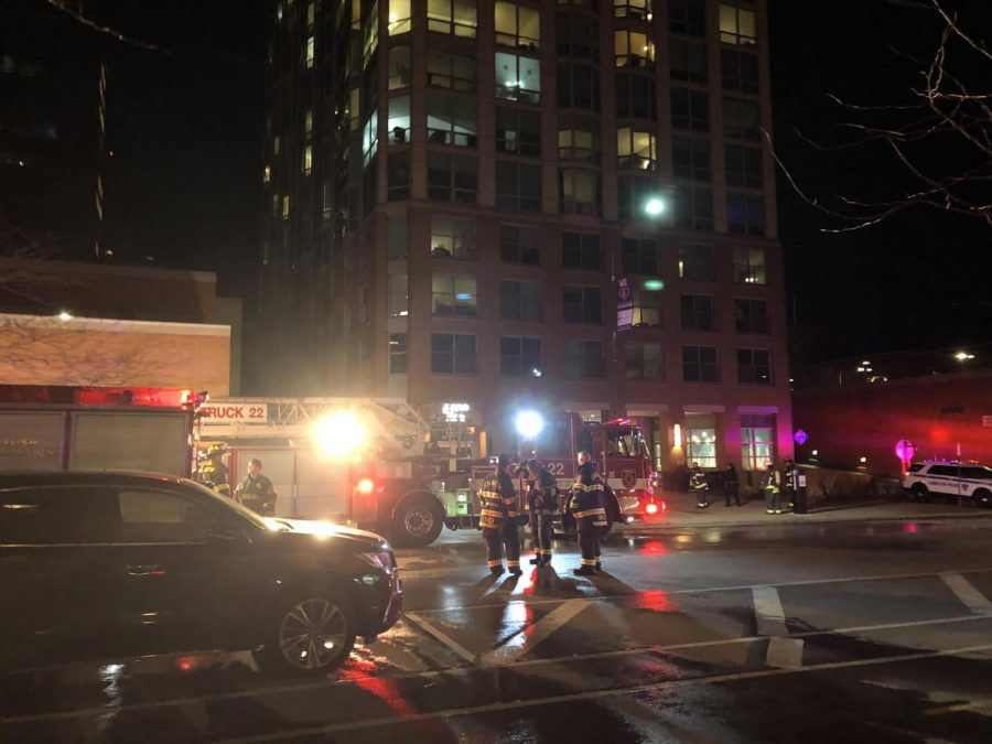 Emergency vehicles outside The Park Evanston, 1630 Chicago Ave. A fire Saturday night displaced residents for almost two hours.