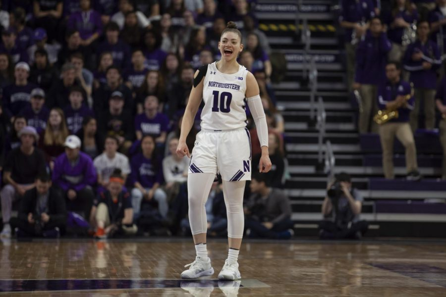 Lindsey Pulliam smiles after a play. The junior had 17 points in NU's win over Illinois on Saturday.