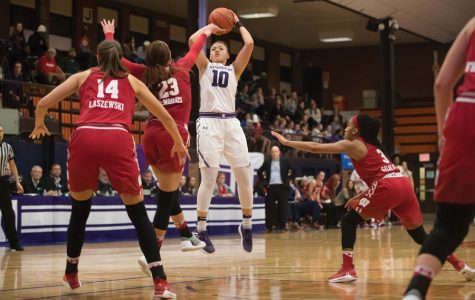 Lindsey Pulliam takes a shot during a 2018 game. The Wildcats played the 2017-18 season at Evanston Township High School while Welsh-Ryan Arena was under renovation.