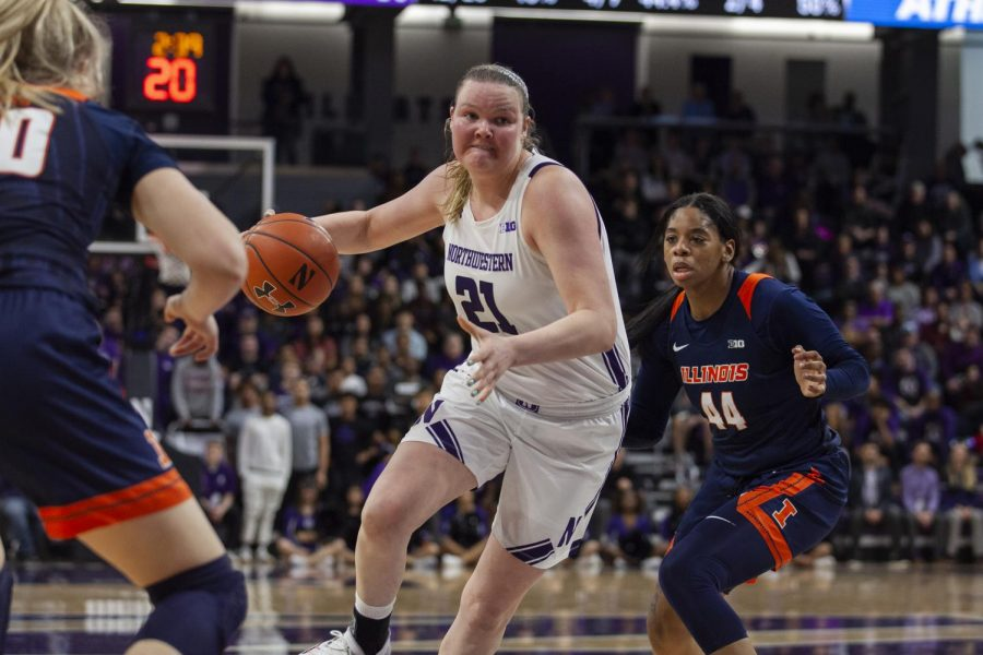 Abbie Wolf makes a move. The senior finished with a team-high 21 points to help the Cats beat Illinois and clinch a share of the Big Ten title Saturday.