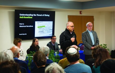 Evanston Mayor Steve Hagerty speaks to community members about the rise of antisemitism on Tuesday. The event, hosted at Beth Emet synagogue, featured a panel.