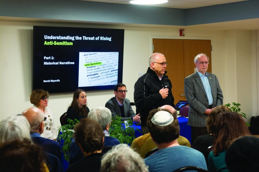 Evanston+Mayor+Steve+Hagerty+speaks+to+community+members+about+the+rise+of+antisemitism+on+Tuesday.+The+event%2C+hosted+at+Beth+Emet+synagogue%2C+featured+a+panel.
