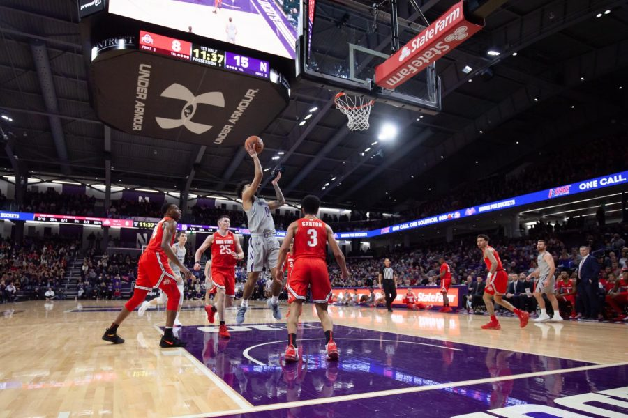 Boo Buie goes up for a shot. The freshman helped Northwestern to its first win in 14 games over Nebraska on Sunday.