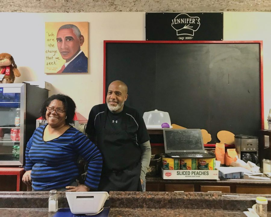 Jennifer and William Eason stand behind the counter at Jennifer's Edibles. William Eason said becoming a part of the Wildcard Advantage Discount program helped attract more NU students to the restaurant.