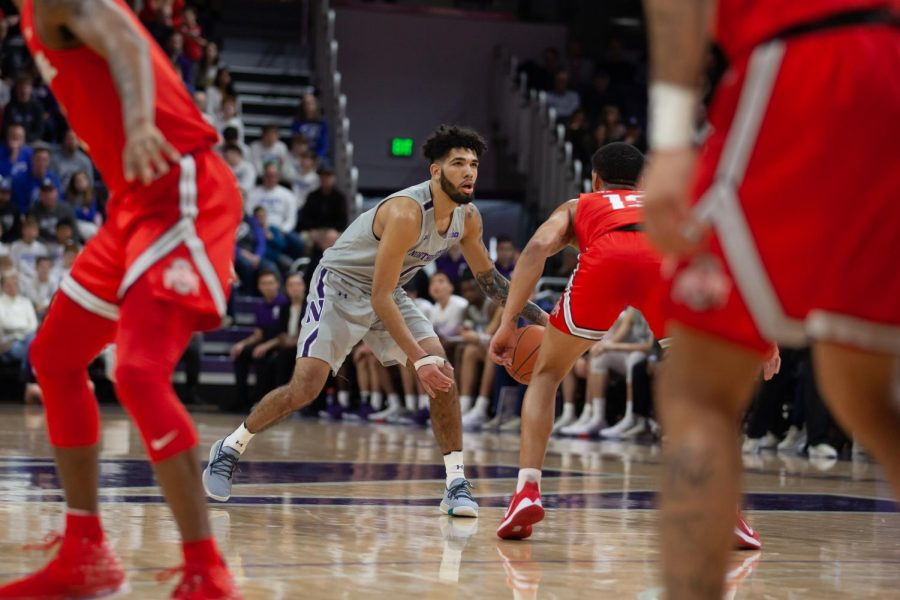 Boo Buie dribbles during a 2020 game. The freshman led the Wildcats to their first win since Jan. 11 on Sunday.
