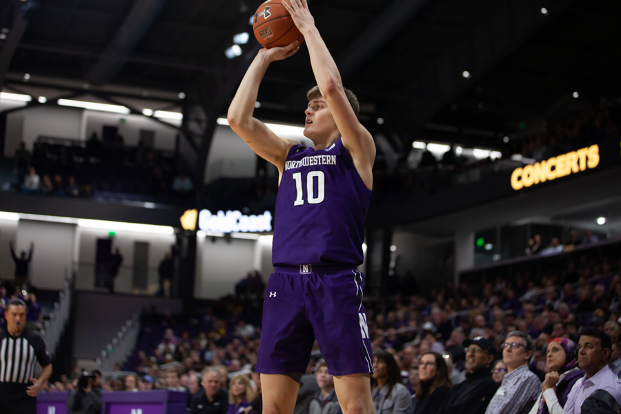 Miller Kopp takes a shot. Kopp scored 14 points in just eight second-half minutes to key Northwestern's blowout win over Quincy.