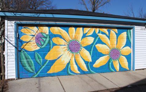 Resident beautifies city with garage door murals