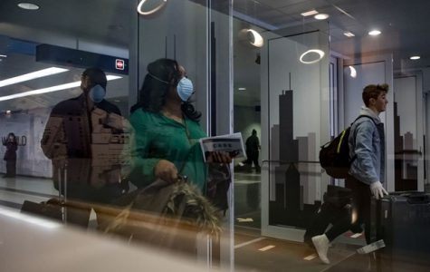 Some passengers wear masks after arriving on international flights on March 15, 2020, at Terminal 5 of O'Hare International Airport amid coronavirus concerns.