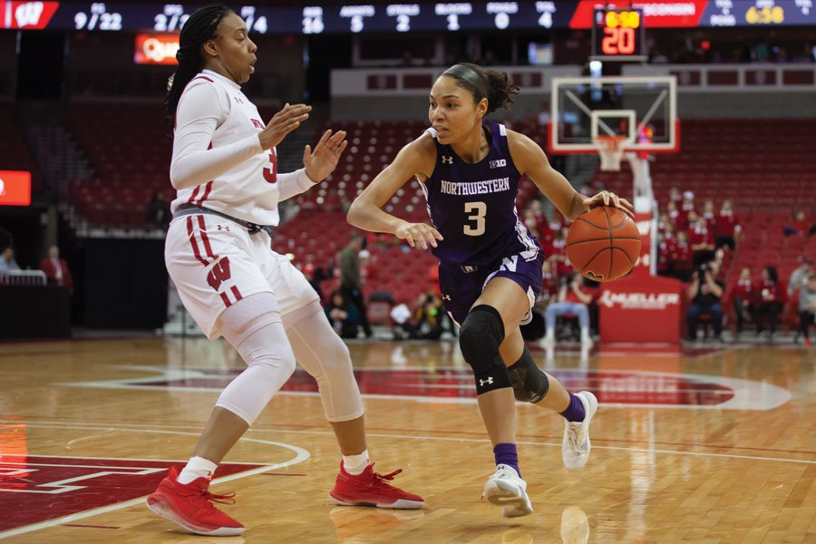 Sydney Wood dribbles against Wisconsin. The sophomore guard is in the midst of a breakout season for the Wildcats.