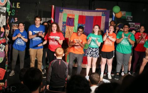 Griffin's Tale members applaud a student who wrote the story they are about to perform. The theatre company encourages students to write creatively and to dig into their imagination.