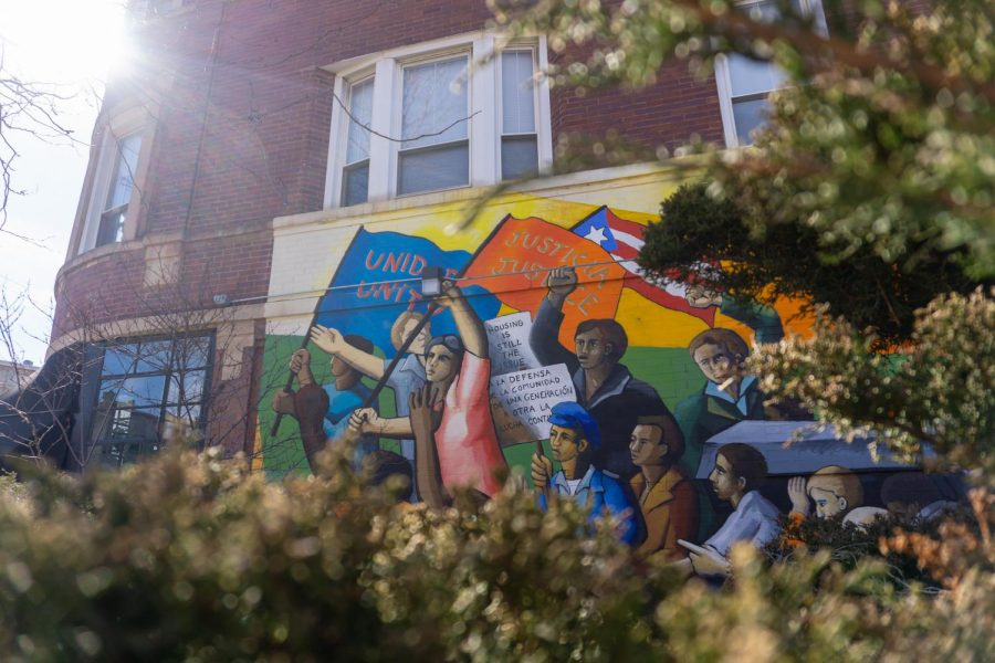 "Located on the corner of Division Street and Hoyne Avenue, ""Together We Overcome"" is one of Chicago's oldest surviving urban artworks. Painted by John Weber, it signifies West Town resident's longing for peace during a time of conflict."
