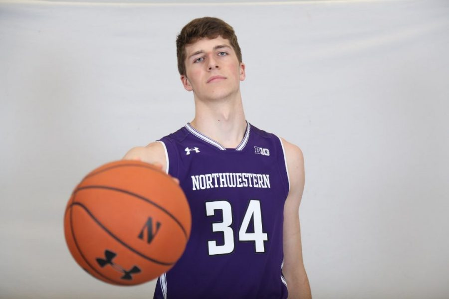 Matt Nicholson poses in a Northwestern uniform. The Michigan native will be the Wildcats' first seven-foot player since 2016 when he joins the team this fall.