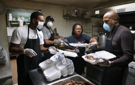 Kevin Murray, Larry Washington, Jennifer Eason, and William Eason prepare meals for seniors in Evanston during the coronavirus pandemic.
