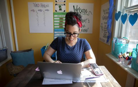 Schubert Elementary kindergarten teacher Mary Carey works in her virtual classroom at her home in Chicago. All e-learning will continue through the academic year.