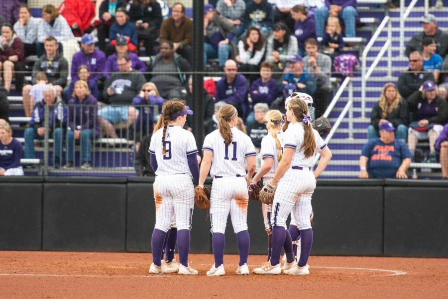 Northwestern's infield gathers at the pitcher's circle during a 2019 game. The Wildcats' season ended after five weeks due to COVID-19.