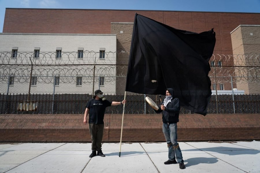 Activists protest outside the Cook County Jail calling for the mass release of incarcerated prisoners, April 7.