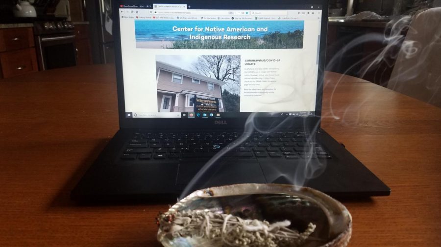 Sage in a bundle burns for a smudging ceremony. CNAIR's program assistant Jennifer Michals has been smudging at their virtual community open houses.