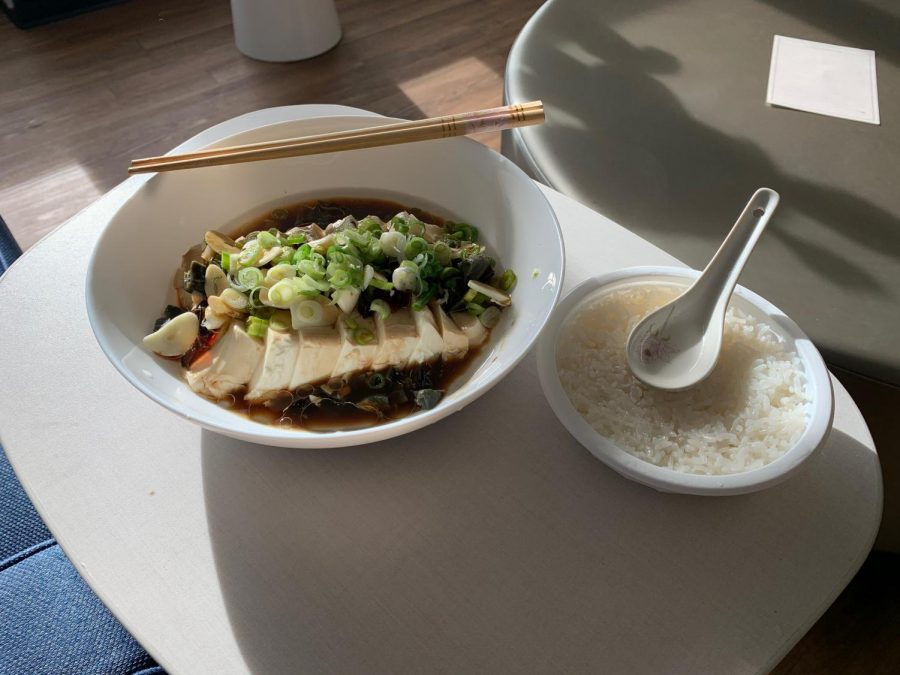 Tony Luo cooks century egg with tofu, a traditional Chinese dish, at his dorm