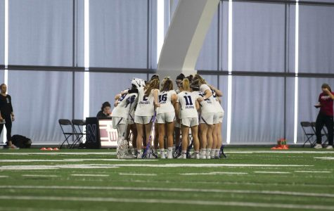 The Wildcats gather in a huddle. NU has been staying connected through Zoom calls, group workouts and TikTok challenges since their season was canceled on March 12.