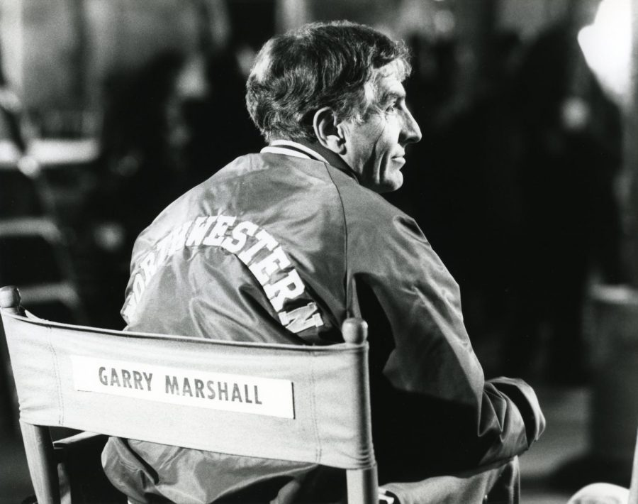 "Director Garry Marshall (Medill '56) works on the set of one of his films. Marshall was the mastermind behind Hollywood blockbusters like ""The Princess Diaries."""