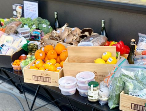 Lush Wine & Spirits sells fruit and vegetable boxes whose contents change daily. Items included are grown locally, like strawberries, heirloom potatoes and rhubarb.