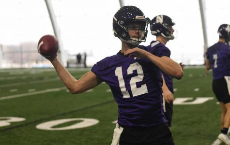 Carl Richardson throws a pass at one of the Wildcats' spring practices. The quarterback graduated high school early to enroll at Northwestern in January.