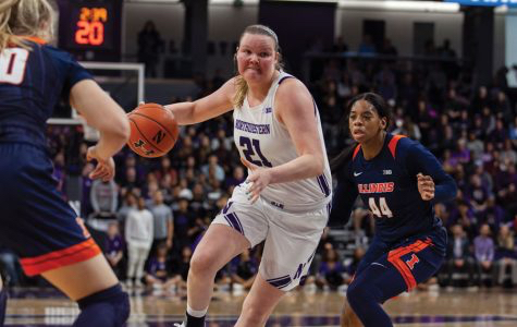 Abbie Wolf drives to the basket in the Cats' Big Ten-clinching win over Illinois. Wolf's NU career is over, but she is still training hard in the hopes of playing professionally in Spain.
