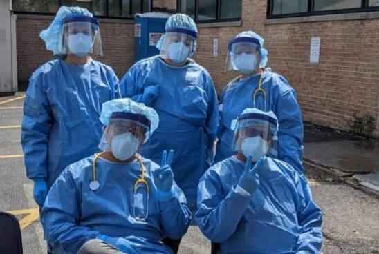 American Indian Health Service workers pose during their first day of coronavirus testing, April 29.