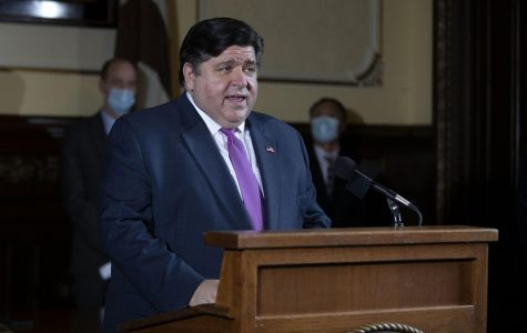 "Illinois Governor J.B. Pritzker speaks during his daily coronavirus pandemic briefing at the Illinois State Capitol Wednesday, May 20, 2020, in Springfield, Illinois. On Friday, Pritzker announced the state is moving into Phase 3 of his announced ""Restore Illinois Plan."""