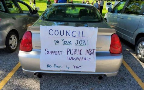 In the hours before the City Council meeting Monday, residents held a socially distant car rally in opposition to the appointment of Storlie as the permanent city manager.
