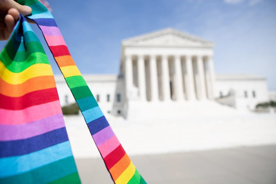 A rainbow stole held in front of the Supreme Court building on June 15, 2020, the day the Court extended civil rights protections to LGBTQ employees.