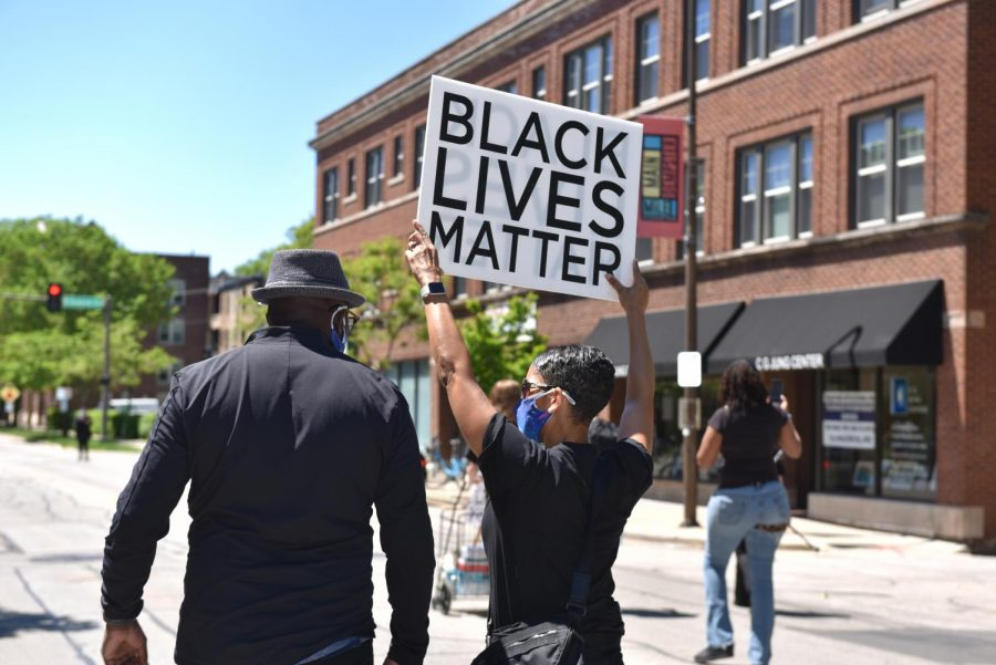 """Protestors carried signs stating """"Black Lives Matter"""" as well as """"Justice for George."""""""