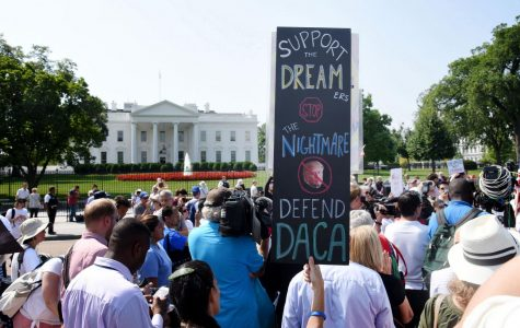 Protesters hold up signs during a rally supporting Deferred Action for Childhood Arrivals, or DACA, outside the White House on Sept. 5, 2017. The Supreme Court blocked the Trump administration's rescission of the program Thursday.