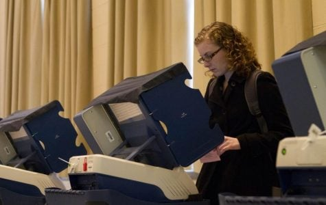 A Northwestern student votes in the 2012 election. With concerns of coronavirus exposure while voting in person, students may choose to skip the ballot box this fall and cast mail-in ballots.