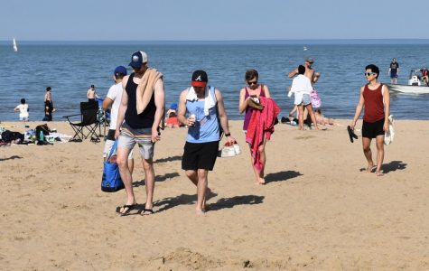 Students and Evanston residents walk on the beach near the Segal Visitors Center. Evanston beaches opened for swimming July 1.