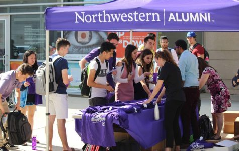 A Northwestern Alumni tent. The Alumni Association has created a directory of alumni-owned small businesses.