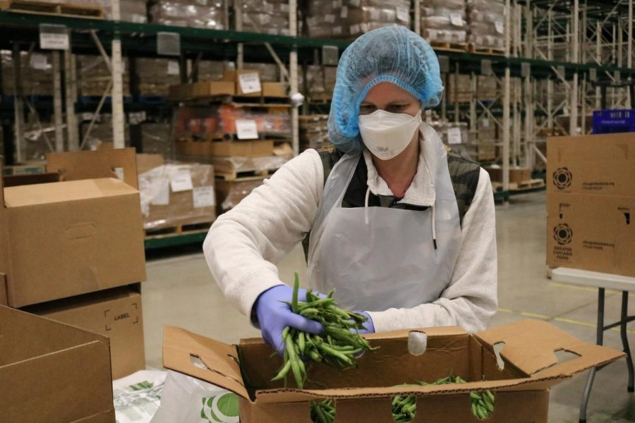 A volunteer packs produce at the Greater Chicago Food Depository's warehouse.