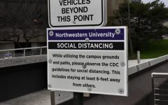 A social distancing sign posted on the Lakefill. A University email announced new safety protocols on top of social distancing in public spaces.